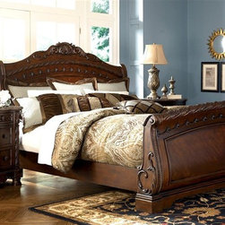 Millwood by ivgStores - Sleigh Bed & Nightstand - North Sea Collectio - Choose Size: QueenGraceful curves, carved pilasters and rosette accents give this sleigh bed and nightstand set a warm, vintage inspired appeal that will be a stunning addition to your master bedroom. The two-piece set is made of wood in dark brown finish, and the nightstand has an inlay stone top. Collection: North Sea. Set includes Sleigh Headboard, Sleigh Footboard, Sleigh Rails, and Nightstand. Color/Finish: Dark Brown. Constructed with select hardwood veneers, hardwood solids and furniture grade resin. Dark casual finish. Dark colored metal accents & hardware. Large scale decorative pilasters and ornately detailed appliques. Serpentine shaped drawer fronts. Diamond patterned inlay stone veneer tops on nightstand. Framed drawer fronts. Cedar veneer or felt lined drawer bottoms. Concealed drawers in nightstand. Mansion sized poster bed with upholstered headboard panel. Inlaid marble veneer caps on panel footboard. Queen Headboard: 65 in. W x 11 in. L x 62 in. H. Queen Footboard: 67 in. W x 11 in. L x 34 in. H. King/California King Headboard: 82 in. W x 11 in. L x 62 in. H. King/California King Footboard: 84 in. W x 11 in. L x 34 in. H. Nightstand: 36 in. W x 20 in. L x 34 in. H