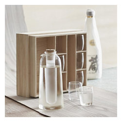 "Roost - Matsuri Sake Set with Ice Carafe Gift Boxed - Form follows function in our smart Matsuri Sake Set. Freeze the tube that nests in the carafe to keep sake chilled without dilution. Crafted from borosilicate glass, the six (6) sake glasses and pretty pitcher arrive in a wood compartment gift box. Box packed separately.   Sake: a Japanese alcoholic beverage of fermented rice often served hot   * Pitcher - 3""dia x 6.75""h  * Cups - 1.5""dia x 3.75""h"
