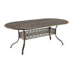 HomeStyles - Floral Blossom Taupe Oval Dining Table - Assembly Required. Hand-applied gold specking sealed with a clear coat. 2-inch umbrella hole. Nylon glides on legs for stability. Stainless steel hardware. Dimensions: 42 in. W X  84 in. D X  29 in. HBy combining outdoor elements such as ceremonial and abstract floral designs, the Floral Blossom 72 Inch Oval Dining Table by Home Style is brought to life. Table is constructed of cast aluminum in a powder coated taupe finish with hand applied gold specking, sealed with a clear top coat. Other features include attractive patterned table top that has 2-inch umbrella hole with black cap, and nylon glides on legs for stability.  Elegant design and sturdy construction, this piece is finished with stainless steel hardware.  Assembly required.  Size: 84w 42d 29h