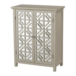 Sterling Industries - Vivienne Mirrored Cabinet in Off White - The Vivienne off-white mirrored cabinet by Sterling brings a casual Mediterranean style to your Decor. Featuring two mirrored panels underneath seamless/Symmetrically carved Mediterranean motif fronts, the cabinet has one shelf inside. Stands 36 inches tall x 28 inches wide and 14 inches deep. Acrylic knobs add a touch of charm.