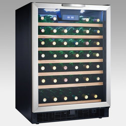 Danby - Danby DWC508BLS 50-Bottle Built-in or Free Standing Wine Cooler Multicolor - DWC - Shop for Wine Refrigerators from Hayneedle.com! Whether wine has a permanent presence in your life or is simply a celebratory treat the Danby 50 Bottle Built-in or Freestanding Wine Cooler will keep your collection at the perfect temperature for whenever the mood strikes. Able to be installed into your kitchen as a permanent appliance or used as a freestanding bar in your rec room this cooler has a digital blue LED thermostat to help you precisely monitor the internal conditions.The tempered glass door has a stainless steel frame and handle which contrast nicely with the beechwood faces on the 6.5 sliding black wire shelves. A cool blue LED track lighting system beautifully showcases up to 50 sparkling bottles without the heat of an incandescent bulb. The reversible hinge lets you hang the door for left- or right-hand opening. An integrated lock with key protects your valuable collection and secures it from curious children.Note: Single Zone wine coolers are intended to store only one type of wine at a time as they have only one temperature zone that can be set to cool either red white or sparkling wine.About Danby ProductsDanby is one of the largest household appliance marketing companies in North America with an impressive lineup of compact specialty and home comfort appliances to suit the lifestyles of today's consumer. Danby's reputation as a leader in the appliance market has been achieved by researching what consumers want and providing quality innovative products at competitive prices to fit their lifestyles.
