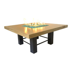 Fire Pit - Fire Table - Concrete & Glass - Fire is one of the few forms of entertainment that is nearly ubiquitous. No matter what kind of music or movie you prefer, no matter if you enjoy the comfort of reading a book or the challenge of climbing a mountain, fire is something that most likely entertains you, and you are not alone in that.