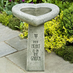 Campania International - Campania International My Heart is in the Garden Bird Bath - B-115-NA - Shop for Garden Bird Baths from Hayneedle.com! What We Like About the My Heart is in the Garden Bird Bath The My Heart is in the Garden Bird Bath is a charming way to show your appreciation of your feathered friends. The large heart-shaped bowl is perched on an elegantly inscribed pedestal. Crafted from cast stone this bird bath is designed for years of enjoyment. A selection of natural finishes complement any outdoor setting.About Campania InternationalEstablished in 1984 Campania International's reputation has been built on quality original products and service. Originally selling terra cotta planters Campania soon began to research and develop the design and manufacture of cast stone garden planters and ornaments. Campania is also an importer and wholesaler of garden products including polyethylene terra cotta glazed pottery cast iron and fiberglass planters as well as classic garden structures fountains and cast resin statuary.Campania Cast Stone: The ProcessThe creation of Campania's cast stone pieces begins and ends by hand. From the creation of an original design making of a mold pouring the cast stone application of the patina to the final packing of an order the process is both technical and artistic. As many as 30 pairs of hands are involved in the creation of each Campania piece in a labor intensive 15 step process.The process begins either with the creation of an original copyrighted design by Campania's artisans or an antique original. Antique originals will often require some restoration work which is also done in-house by expert craftsmen. Campania's mold making department will then begin a multi-step process to create a production mold which will properly replicate the detail and texture of the original piece. Depending on its size and complexity a mold can take as long as three months to complete. Campania creates in excess of 700 molds per year.After a mold is completed it is moved to the production area where a team individually hand pours the liquid cast stone mixture into the mold and employs special techniques to remove air bubbles. Campania carefully monitors the PSI of every piece. PSI (pounds per square inch) measures the strength of every piece to ensure durability. The PSI of Campania pieces is currently engineered at approximately 7500 for optimum strength. Each piece is air-dried and then de-molded by hand. After an internal quality check pieces are sent to a finishing department where seams are ground and any air holes caused by the pouring process are filled and smoothed. Pieces are then placed on a pallet for stocking in the warehouse.All Campania pieces are produced and stocked in natural cast stone. When a customer's order is placed pieces are pulled and unless a piece is requested in natural cast stone it is finished in a unique patinas. All patinas are applied by hand in a multi-step process; some patinas require three separate color applications. A finisher's skill in applying the patina and wiping away any excess to highlight detail requires not only technical skill but also true artistic sensibility. Every Campania piece becomes a unique and original work of garden art as a result.After the patina is dry the piece is then quality inspected. All pieces of a customer's order are batched and checked for completeness. A two-person packing team will then pack the order by hand into gaylord boxes on pallets. The packing material used is excelsior a natural wood product that has no chemical additives and may be recycled as display material repacking customer orders mulch or even bedding for animals. This exhaustive process ensures that Campania will remain a popular and beloved choice when it comes to garden decor.Please note this product does not ship to Pennsylvania.