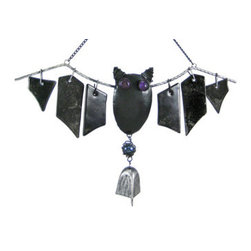 Cool Metal And Glass Bat Windchimes Halloween - These cool metal and glass bat wind chimes are great for Halloween or all year round!. The bat's body and the frame of his wings are made of metal, and the wings are made of pieces of thick, free hanging glass that create a soothing tinkling sound when the wind knocks them together. a metal bell hangs from the bat's body to provide even more sound. The bat is 16 inches long, 9 inches tall and the black metal hanger is 7 inches above the bat. It makes a great gift for bat lovers.