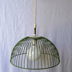 Metal Basket Light by Purple Darby - Have you ever seen a basket used on a light? To make this, a dreamy green vintage basket was repurposed into a really cool lampshade. It's such a clever idea.