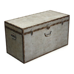 Kathy Kuo Home - Industrial Loft Rustic Iron Gray Rust Lock Floor Trunk Coffee Table - Everyone can appreciate a good old travel trunk, one that speaks the stories as well as the many possible adventures it holds.  Made of galvanized steel, this distressed gray trunk is oxidized for a rusty finish and is the perfect size for the foot of the bed or a unique coffee table.  It is sure to make a place for itself in the industrial loft, rustic bedroom or living room.