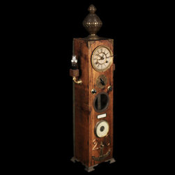 Chiming Tower Clock - A functional clock sculpture made from vintage clock mechanisms and various idiosyncratic treasures. On every hour, the tower releases a few calming tones as its' pendulum rocks back and forth. This piece is newly made with vintage parts.