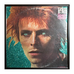 """Glittered David Bowie Space Oddity Album - Glittered record album. Album is framed in a black 12x12"""" square frame with front and back cover and clips holding the record in place on the back. Album covers are original vintage covers."""