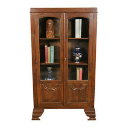Antique Solid Oak Art Deco Bookcase Bookshelf Cabinet - This beautiful antique oak bookcase has a rounded edge top with a raised trim frieze. There are two glass cabinet doors with an arched trim at the top of the glass and paneled bottoms with half circle raised accents. The base of the doors hides the lower shelf when the doors are closed. The three wooden shelves are adjustable by approximately 4 inches (dimensions given are where they were photographed). There is a key present allowing you to secure your books and other items from unauthorized handling. The right cabinet door has a raised trim at the center to hide the gap between the doors. Standing solidly on scalloped cut, multi-tiered bracket feet this handsome bookcase will be a nice addition to any room you display it in.