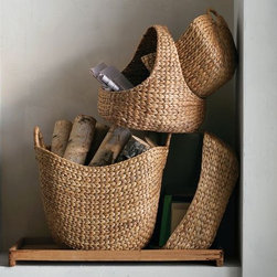 Curved Basket Collection - Made from renewable water hyacinth, these gorgeous baskets will add a touch of warmth to your home and provide excellent storage for hats and mittens this winter.