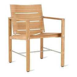 """Elan Dining Armchair - Axel Enthoven has been a mainstay in the furniture design world for decades – winning his first industry award in 1969 – so it's not surprising that he created one of the first molded teak chairs for outdoor use. (And tested it by submerging it in water for eight months.) Together with his partners Jean-Pierre Geelen and Alain Denis, the designer operates his international design studio from offices in both the Netherlands and France. Elan (2008) represents a watershed moment (no pun intended) for the three designers, who wanted to combine the beauty and sculpted lines of a molded plywood chair with the durability required for outdoor living. The Elan Chair passed the water test and did not delaminate. (Teaching the chair to swim is another matter.) With solid teak frames and laminated teak seats and backs, these chairs are stronger than many solid teak equivalents due to the designers' use of state-of-the-art veneering and cross-lamination techniques. The teak used to make Elan is harvested from strictly managed plantations that follow good practices for the environment, the workers and the local communities. Cushions (sold separately) are available in Sunbrella® """"Linen"""" or """"Meridian"""" acrylic fabric, which resists fading or mildewing, even when exposed to extremes of sunlight, temperature and moisture. Suitable for residential, hospitality and contract use. Made in Indonesia."""