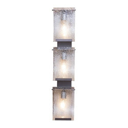 """Varaluz - Rain Three Light Vanity Light in Rainy Night - Features: -Three light vanity light. -Rain Collection. -Rainy night Low-VOC finish. -Recycled hand pressed rain glass shade. -Transitional style. -Hand-forged steel has 70 % or greater recycled content. -Spa feeling. -Suitable for interior usage. -Suggested room: Bathroom. -UL rating: Dry. -UL-C listing. -1 Year manufacturer warranty. Specifications: -Accommodates: (3) 100W medium base bulbs (not included). -HCO: 16"""". -Product extension: 4.88"""". -Back plate thickness: 0.63"""". -Back plate dimensions: 26"""" H x 4.38"""" W. -Shade dimensions: 9.88"""" H x 6.25"""" W. -Overall dimensions: 33.25"""" H x 7"""" W."""