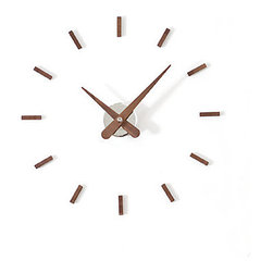 Nomon Sunset Clock - I love the simplicity of this midcentury modern design. It's perfect for a space that desires a hint of Mad Men–era design but isn't ready to commit wholeheartedly. I personally think it would look fabulous against a white wall amidst a collage of framed art and photographs.