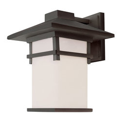 Transglobe - Trans Globe 40022 Coach Lantern - 10W in. - 40022 BK - Shop for Wall Mounted from Hayneedle.com! The Transglobe 40022 Coach Lantern - 10W in. could easily fit in with the decor in a traditionally styled home or as part of your backyard Japanese garden. No matter how you use this versatile fixture you'll come to love the warm light that radiates from the tea-stain glass shade. The metal body is available in your choice of finishes so you can always find the look that's right for your home.About Trans Globe Lighting Inc.Born from the hopes and dreams of two entrepreneurial spirits in 1986 Trans Globe Lighting offers one of the most comprehensive and stylish collections of residential lighting in the world. This family-owned company based in North Hollywood Calif. is marked by personal involvement with a wide variety of products available at the lowest prices. From traditional to ultra-contemporary in style Trans Globe has just the right light for you.
