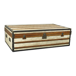 """Small Polo Club Trunk - The small polo club trunk measures 28.1 x 48 x 20.9"""". Once there was a time when porters took care of luggage. Appearing elegant and decorative, an army of trunks were loaded into the baggage car or the ship's hold. Royalty and upper-class in the Belle Epoque traveled with specialized trunks. Armoires, bars, libraries, and of course hat-trunks and trunks for the prize-winning poodle. Antique French trunks with famous brand names now catch exorbitant sums at auction. Except for the logo, our trunks are closely inspired by the old, classic travel trunks of yore. Canvas covered. Solid brass hardware. Steamer-varnished hardwood slats. Ideal as coffee tables, combining storage with functionality and design! Every trunk carries two sliding trays painted in signal-red. Roomy and strong, heirlooms for generations to come."""