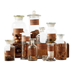 Botany Apothecary Jars - Set of 9 - Antiqued labels bring the romantic fascination of the age-old apothecary to your home.  The Botany Apothecary Jars is a set of nine clear glass bottles - useful in the bath, the kitchen, and any part of your decor - including three each of a standard, a wide-necked, and a cylindrical design.  Compose a vintage-inspired statement with this striking set.