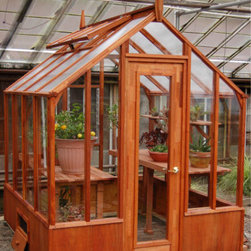 Trillium Greenhouse - This beautiful greenhouse is made of redwood and cedar, giving it a natural look that will blend right into your back yard oasis. It's a sizable structure but not so big that it won't fit into a more compact back yard setting. Redwood benches are available to trim out the package.