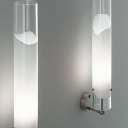 """Vistosi - Vistosi Lio thin wall sconce - The Lio thin wall sconce by Vistosi has been designed by Archivio Storico Vetereria Vistosi 1972. This blown glass sconce was created with technique that enables modeling a white glass band into several layers of crystal. It radiates a glow of light to any decor. This beautiful light has been handmade on the Venetian island of Murano. Every light comes with a certificate of authenticity.  Product Description:The Lio thin wall sconce by Vistosi has been designed by Archivio Storico Vetereria Vistosi 1972. This blown glass sconce was created with technique that enables modeling a white glass band into several layers of crystal. It radiates a glow of light to any decor. This beautiful light has been handmade on the Venetian island of Murano. Every light comes with a certificate of authenticity.                         Manufacturer:             Vistosi                            Designer:                         Archivio Storico Vetereria Vistosi 1972                                         Made in:            Italy                            Dimensions:                         width: 3.1"""" ( 8 cm )  height: 19.1"""" ( 48.5  cm )             projection: 4.7"""" ( 12 cm)                                         Light bulb:                         1x 100W Incandescent or 1x 150W Halogen or              1 x 23W Flourescent                                         Material                         white with clear crystal"""