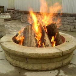 Fire Pits - This firepit can be installed in less than 15 minutes. The kit includes everything you need; the concrete pieces, the steel ring, and the sand for the bottom.