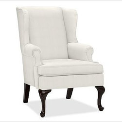 "Gramercy Upholstered Wingback Armchair, Washed Linen/Cotton Ivory - A design standout, this armchair has sloping wings, double-scroll arms and cabriole legs that define it as a Queen Anne Wingback. 29.5"" wide x 34"" deep x 42"" high Corner blocked frame for structural integrity. Tight back is thickly padded for extraordinary comfort. Heavy gauge sinuous springs support a T-shaped seat cushion with a solid foam core that's wrapped in plush padding. Espresso-stained hardwood legs. This item can also be customized with your choice of over {{link path='pages/popups/fab_leather_popup.html' class='popup' width='720' height='800'}}80 custom fabrics and colors{{/link}}. For details and pricing on custom fabrics, please call us at 1.800.840.3658 or click Live Help. View and compare with other collections at {{link path='pages/popups/furniture_DOC.html' class='popup' width='720' height='800'}}Upholstery Furniture Facts{{/link}}. Watch a video about the high quality of our {{link path='/stylehouse/videos/videos/pbq_v22_rel.html?cm_sp=Video_PIP-_-PBQUALITY-_-OUR_UPHOLSTERY' class='popup' width='950' height='300'}}upholstered furniture{{/link}}. Made in USA."