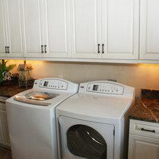 Mediterranean Laundry Room by Faralli Kitchen and Bath Design Studio