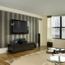 Contemporary Home Theater by M. GRACE DESIGNS, INC.