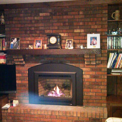 Fireplace Xtrordinair - Gas Fireplace Inserts - We installed a direct vent gas insert in this existing masonry fireplace. The customer decided to use an arched panel kit to soften the look of the fireplace agianst the brick.