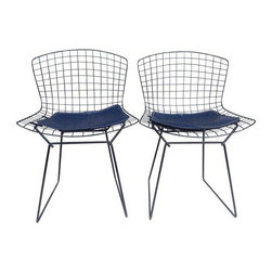 """Pre-owned Harry Bertoia Black Side Chairs - A Pair - An authentic pair of vintage Harry Bertoia arm chairs from the 1960s, that come complete with the original Knoll chair pads. These are in fantastic condition with the original paint. There are no breaks in the metal mesh, and very little wear for their age. Enjoy these perfect little iconic Mid-Century gems!    Seat height is 18""""."""