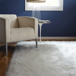 Alexander Home - Jungle Sheep Skin White Rug (5' x 7'6) - Add a layer of romantic softness to any floor in your home with this 5' x 7'6' faux sheepskin rug that features a plush ivory construction. The one-inch pile is perfect for bare feet to step on,no matter what decor style you gravitate toward.