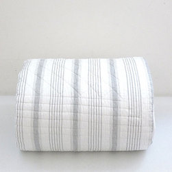 Matteo Ticking Stripe Quilt - Here is a quilt that would suit a beach house in California, just as well as it would a farm in upper state New York. Now if only I had either. If I cuddle up in this casually cool and lightweight quilt, I can almost imagine I do.