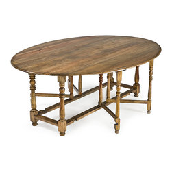 Frontgate - Oval Drop Leaf Dining Table - Made of solid hardwood. Natural stain finish will have variations in color due to grain pattern. Gate legs provide firm support to the swinging leaves. Turned gun barrel legs. Equally at home in your city loft as it is in your grand estate, the elegant Oval Drop Leaf Dining Table is both modern and rustic. The gate legs operate very smoothly while the drop leaf can expand to accommodate a crowd and close back up when it's not in use.  .  .  .  .