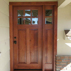 Exterior Simpson Door - New Simpson wood door with right sidelite gives this home a needed face lift.