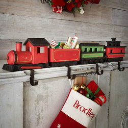 """Horchow - Four Train Christmas Stocking Hooks - Four Train Christmas Stocking HooksDetailsHandcrafted of mango wood and metal.Four-piece set includes one stocking hook of each of the following sizes: 7""""L x 5.25""""W x 8.25""""T; 7""""L x 5""""W x 7.25""""T; 7.125""""L x 5.75""""W x 8.125""""T; 6.75""""L x 5.25""""W x 6.125""""T.Imported."""