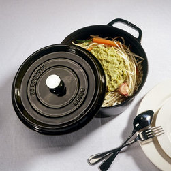 Staub - Staub Round Cocotte - 5.5 qt. - Black Matte - 1102625 - Shop for Baking & Roasting Dishes from Hayneedle.com! Get flavorful results every time with the Staub Round Cocotte - 5.5 qt. - Black Matte. The extra-heavy lid of this pan seals moisture in and dozens of well-placed spikes continuously baste the food below ensuring your dish retains the full flavor of each ingredient. Clean up is easy. This pan is dishwasher-safe. Plus the high-quality enamel coating resists scratches and will never discolor.About Staub CookwareFrom professional chefs to home cooks people with a passion for cooking rely on Staub cookware. Combining the utility of cast iron with the latest technology available Francis Staub designed his first enameled pot in 1974 in the Alsace region of France. Known for performance style and durability Staub has become the benchmark for enameled cast-iron cookware. Ideal for braising searing roasting and caramelizing food Staub's signature pots - called cocottes - feature an enameled interior with a matte black finish. Resistant to rust chipping and cracking cocottes are available in round and oval shapes in a variety of sizes and colors. Just right for slow-cooking food Staub cocottes are designed to provide even heat distribution excellent heat retention and continuous self-basting. The inside of each heavy snug-fitting lid features a series of bumps (or self-basting spikes) to allow continuous natural basting by distributing moisture throughout for extra flavor and tenderness. In addition to its signature cookware which is perfect for serving at the table Staub also offers pans for frying sauteing grilling and roasting as well as a variety of teapots accessories and gourmet specialty items.