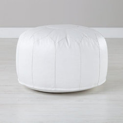 Faux Leather Seats Come Standard, White - This cute little (durable, stain-proof) pouf from Land of Nod is bound to end up traveling from room to room — and that's part of what makes it so great. Put your feet up on it in the family room, use it as a kids' perch, or stick a tray on it and use it as a table.