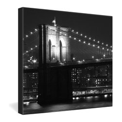 DENY Designs - Leonidas Oxby Brooklyn Bridge 125 Gallery Wrapped Canvas - Leonidas Oxby's nighttime photo of a softly glowing Brooklyn Bridge captures the romance of New York City. The black and white photo is dye-printed onto a 1 1/2-inch-deep, frameless canvas for a contemporary presentation. For lovers of modern urban culture and style.