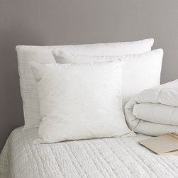Organic Chamber Pillows - With their 230-thread-count organic cotton shells, these Standard and King pillows are filled with a blend of feathers and down that's been treated with Freshness Assured, a meticulous 15-step cleaning process that makes the down hypoallergenic and ensures its purity and loft. The pillows are also available with a down-alternative fill.