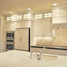 Kitchen inspiration.  Would not have panels on fridge.  Would want different fix
