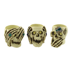 n/a - See, Hear, Speak No Evil Skull Tealight Candle Holders - This trio of tealight candle holders is a wonderful addition to your home for Halloween, or year round. One skull can see no evil, one skull can hear no evil, and the third can speak no evil. Made of cold cast resin, each skull measures approximately 3 1/2 inches high, 3 1/2 inches wide, 4 inches long, and accommodates up to 1 3/4 inch diameter tealight candles. Each piece is adorned with stones for a splash of color. The set makes a great gift for collectors of macabre art, and it is sure to be admired.