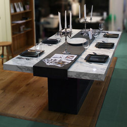 Stone Table for Grand designs show - The beautiful polished marble table top is held in place by a raised band of black brushed textured granite that wraps round the end of the table to make the leg and base creating a continuous loop.