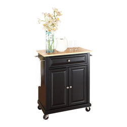 Crosley Furniture - Crosley Furniture Natural Wood Top Kitchen Cart in Black - Crosley Furniture - Kitchen Carts - KF30021EBK - Constructed of solid hardwood and wood veneers this portable kitchen cart is designed for longevity. The beautiful raised panel doors and drawer front provide the ultimate in style to dress up your kitchen. The deep drawer is great for anything from utensils to storage containers. Behind the two doors you will find an adjustable shelf and an abundance of storage space for things that you prefer to be out of sight. The heavy duty casters provide the ultimate in mobility. When the cabinet is where you want it simply engage the locking casters to prevent movement. Style function and quality make this portable kitchen cart a wise addition to your home.