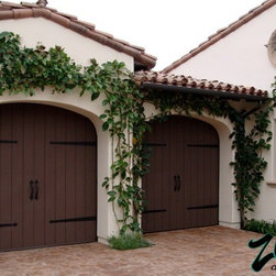 Eco Spanish Colonial Garage Doors - Years of industry experience have enabled Ziegler to combine the perfect blend of raw materials and hardware to ensure smooth operation complete with a lifetime warranty. Choose on of our designs or create your own.