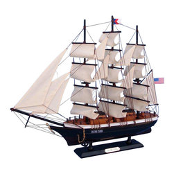 Handcrafted Nautical Decor - Flying Cloud 20'' - SOLD FULLY ASSEMBLED--Ready for Immediate Display - Not a Model Ship kit --This fine tall ship model of the famous clipper ship Flying Cloud is perfectly sized for any shelf, desk, or mantle. Renowned for her speed and endurance sailing the open seas, these proud tall ship models of the Flying Cloud add a touch of historic spirit and flair of nautical Decor to any bedroom, den, or office. ----------    Arrives fully      assembled with      all sails mounted--    Handcrafted wooden hull and masts--    Historically      accurate sail      configuration and extensive rigging--    2 anchors with metal chain attached--    21 handsewn white cloth sails--    --    Metal nameplate on wooden base identifies the ship as the Flying Cloud--