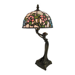 Bronzed Woman Figural Accent Lamp with Stained Glass Shade - This lamp adds a beautiful accent to entry way tables, end tables, and nightstands in your home. The metal base features a woman leaning over to hold up the stained glass shade. The shade is made of hundreds of hand cut pieces of opalescent glass and gives a soft pink glow when lit. The lamp measures 20 1/2 inches tall, has an 8 inch diameter shade, and has a black 5 1/2 foot long power cord with a rocker on/off switch. It uses a 25 watt (max) type B bulb (included). This piece is sure to be admired, and makes a great gift. NOTE: The harp and finial are packaged on the outside of the styrofoam, separate from the lamp and shade.