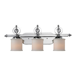 Golden Lighting - Golden Lighting Cerchi Chrome Three Light Vanity Light - Golden Lighting specializes in the design and manufacture of high quality residential lighting products and accessories. Since 1982 they've built a reputation on the outstanding value of their products and have carefully crafted an extensive range of product families that are designed to simplify the light buying decision and complement every room in the home. Golden Lighting's mission is to be every customer's premier choice for quality lighting products and service. Golden Lighting's core values are:   Provide superior customer service and quality products  Honor commitments be consistent and fair  Promote true teamwork based on cooperation trust and a positive attitude  Ensure company growth by generating reasonable profits and reinvesting those profits back into their people and products  Maintain a strong community presence  Continually seek improvement and innovation in every aspect of their business  Features include Sophisticated sleek modern style creates glamour Polished Chrome finish and clear acrylic accents mirror reflected light for an elegant gleam Drum-shaped Etched Opal glass on chandeliers and bath resembles a handmade fabric shade Column rings can be rotated for either a linear look or a whimsical feel Etched Opal glass Provides a well diffused light over a vanity or mirror for grooming UL listed Damp location for use in bathroom. Specifications Finish: Chrome Glass/shade Finish: Etched Opal Glass Safety Rating: ULCUL Fixture Application: Damp Location Energy Saver: No Energy Star Compliant: No Dark Sky Compliant: No Ada Compliant: No Title 24 Compliant: No Extension: 6.5 Inches Number Of Bulbs: 3 Max Wattage Per Bulb: 100W Total Wattage: 300W Bulb Type: Incandescent Type A Bulb(s) Included: No.