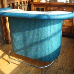 Chromcraft Vinyl Dry Bar - There's nothing so perfectly retro as a bar. I love the idea of this curvy blast of turquoise lighting up a dark basement, whether it's used for its intended function or not. I would build up the color by surrounding it with translucent pinks, lavenders and yellows in things like lucite panels, chairs and side tables.