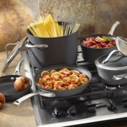 Calphalon Contemporary Nonstick 8-Piece Cookware Set - Easy cleanup and easy, nonstick cooking make the Calphalon Contemporary Nonstick 8-Piece Cookware Set an easy choice for your new (or upgraded) kitchen. The set comes complete with an eight-inch fry pan, ten-inch fry pan, 1.5-quart sauce pan with cover, 2.5-quart sauce pan with cover, and an eight-quart stock pot with cover. Triple-layer, PFOA-free nonstick material offers the best in durability, and it's dishwasher safe, too. The pans are crafted of heavy-gauge, hard-anodized aluminum for even heating, and the loop-style handles are built tough out of durable cast stainless steel. Includes manufacturer's lifetime warranty.About CalphalonCalphalon's mission is to be the culinary authority in kitchenwares, enhancing the home chef's food experience during planning, prep, cooking, baking, and serving. Based in Toledo, Ohio, Calphalon is a leading manufacturer of professional quality cookware, cutlery, bakeware, and kitchen accessories for the home chef. Calphalon is a Newell-Rubbermaid company.Calphalon's goal is to give you, the home chef, all the tools you need to realize your highest potential in the kitchen. From your holiday roasting pan to your everyday fry pan, count on Calphalon to be your culinary partner - day in and day out, for breakfast, lunch, and dinner for a lifetime.