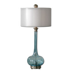 Uttermost - Junelle Blue Glass Table Lamp - Add this unique table lamp for the ultimate accent to your sophisticated room. The cool and calming palette of blue glass and a silver-toned shade make this ideal for your chic sensibilities. Place it next to your sofa or on your desk for a shot of sleek style.
