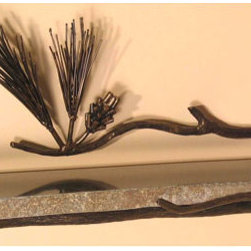 Pine Boulder Shelf - This shelf is a very unique piece. It has an iron bracket with pine details that grow around the granite boulder shelf. Each granite shelf is carved out of a single piece of natural boulder, and will vary in size, shape and color.