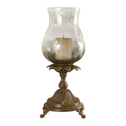 Uttermost Chandell Distressed Candleholder - Heavily distressed aged black with a red rust glaze and smoky gray glass globe. White candle included. Features a heavily distressed aged black base with a red rust glaze and smoky gray glass globe. White candle included.